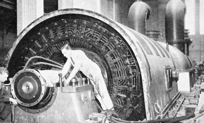 Erecting the stator for one of the turbo-alternators in Battersea Power Station