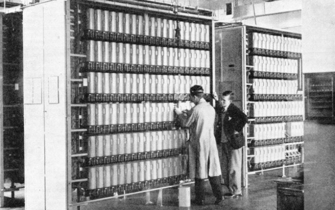 A SECTION OF LONDON'S FIRST AUTOMATIC EXCHANGE—at Holborn. The apparatus is pare of the Tandem exchange which transmits calls from one manual exchange to another, thus effecting a considerable saving of time.