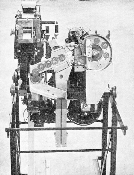 OPERATED BY COPPER COINS, this mechanism is used in ticket-issuing machines