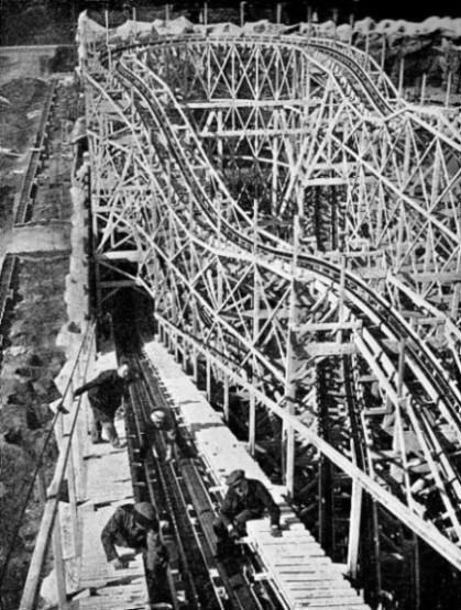 LAYING THE PULL-UP CHAIN on a new gravity ride, or coaster, at Felixstowe