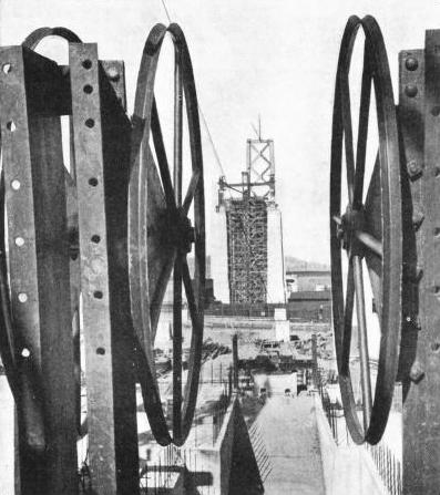 THESE LARGE WHEELS were mounted at the end of the suspension bridge to reel out the cables supporting the roadways