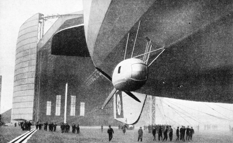The airship Hindenburg leaving her enormous hangar