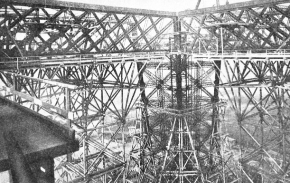 THE INTRICATE MASS OF IRONWORK at the level of the first platform of the Eiffel Tower
