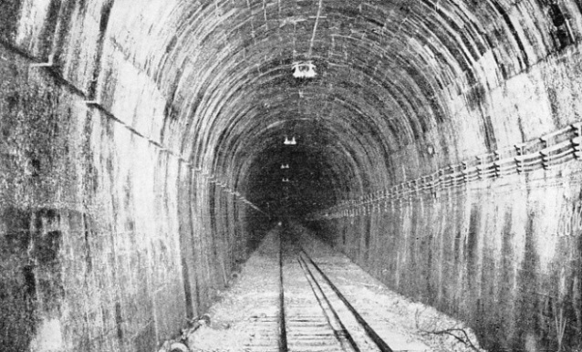 DEAD STRAIGHT FROM END TO END, the Otira Tunnel has a total length of 5 miles 445 yards