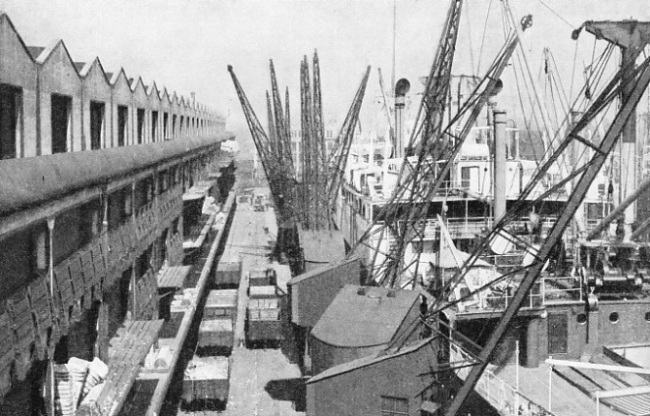 BALES OF INDIAN COTTON being discharged at Manchester Docks