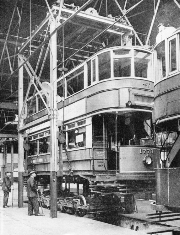 REMOVING THE BODY OF A TRAMWAY CAR from its trucks by means of an electric hoist