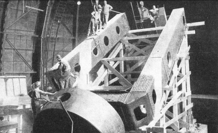 THE WESTERN MEMBER OF THE POLAR AXIS of the 100-in Hooker telescope being swung into position