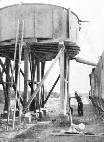 LARGE WATER TANK from which locomotives draw water on the long journeys across the arid regions of the Australian continent