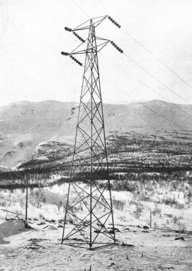 ONE OF THE STEEL PYLONS which carry the transmission fines of the Iron Ore Railway