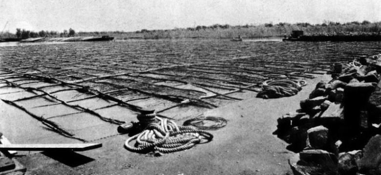 WILLOW MATTRESS floating on the surface of the river Mississippi at the site of main river pier