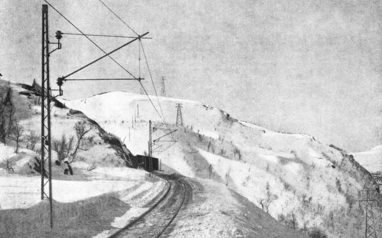 OVER SNOWCLAD MOUNTAINS the track of the Iron Ore Railway was built in the face of all the privations and dangers of Arctic weather