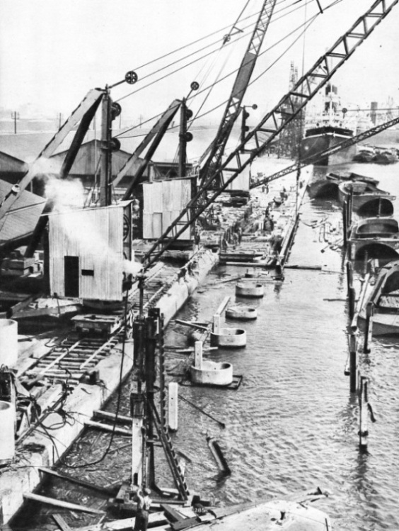 WIDENING THE QUAYS on the north side of Royal Albert Dock